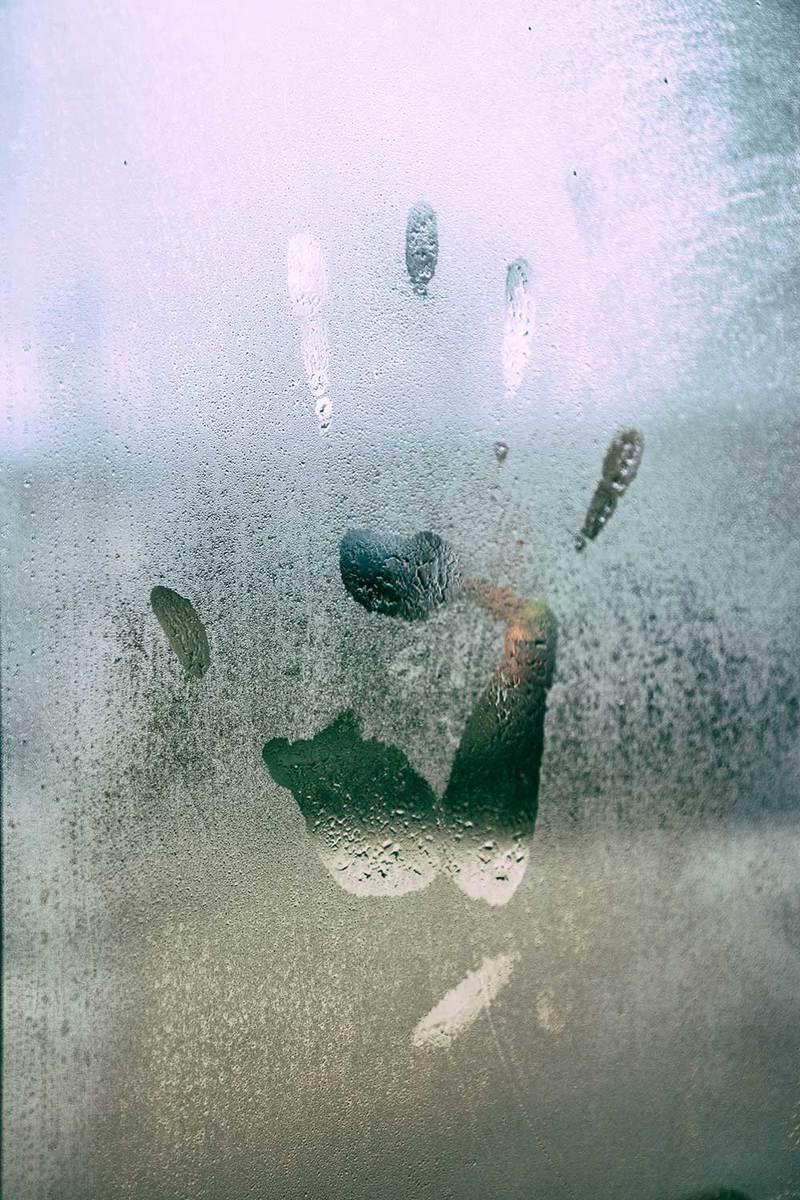 hand print in a wet window xfh36b7